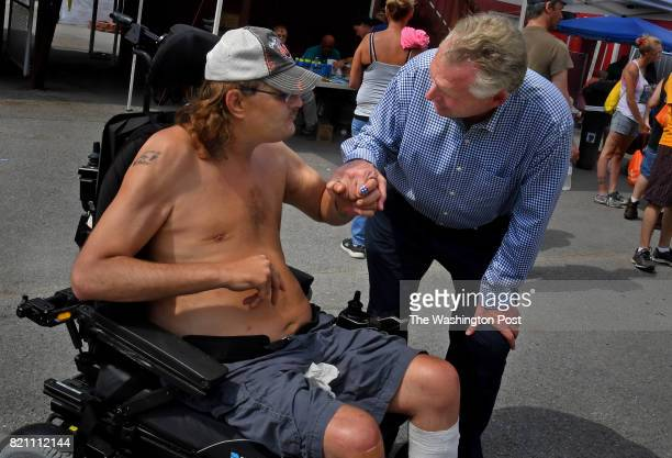 Virginia Gov Governor Terry McAuliffe chats with Joey Johnson of Clintwood Va who is confined to a wheelchair The 41yearold Johnson shot himself in...