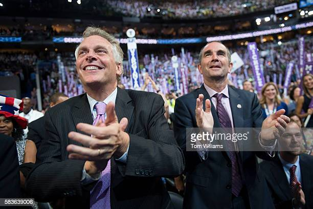 Virginia Gov Terry McAuliffe left and Lt Gov Ralph Northam cheer on the floor of the Wells Fargo Center in Philadelphia Pa on the first day of the...