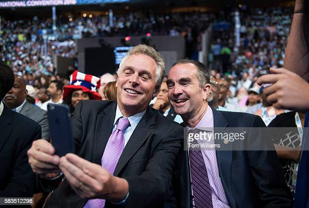 Virginia Gov Terry McAuliffe left and Lt Gov Ralph Northam take a selfie on the floor of the Wells Fargo Center in Philadelphia Pa on the first day...