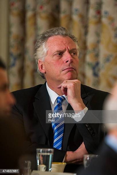 Virginia Gov Terry McAuliffe listens to US President Barack Obama speak to the National Governors Association in the State Dining Room of the White...