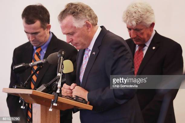 Virginia Gov Terry McAuliffe observes a moment of silence with Lt Gov Ralph Northam and Virginia Attorney General Mark Herring during a worship...