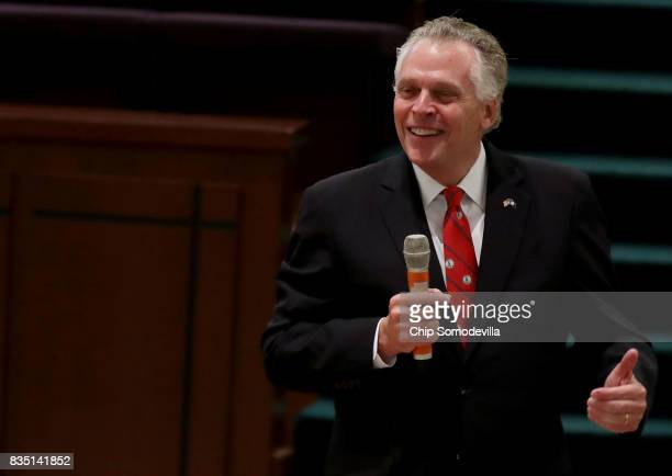 Virginia Governor Terry McAuliffe delivers remarks during the funeral for TrooperPilot Berke MM Bates at Saint Paul's Baptist Church August 18 2017...