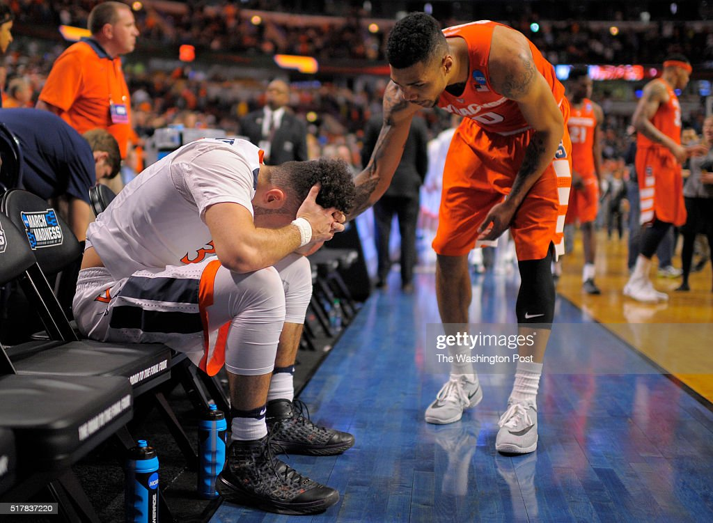 Virginia guard London Perrantes left is consoled by Syracuse forward Michael Gbinije after Syracuse defeats Virginia 68 62 to win the Midwest...