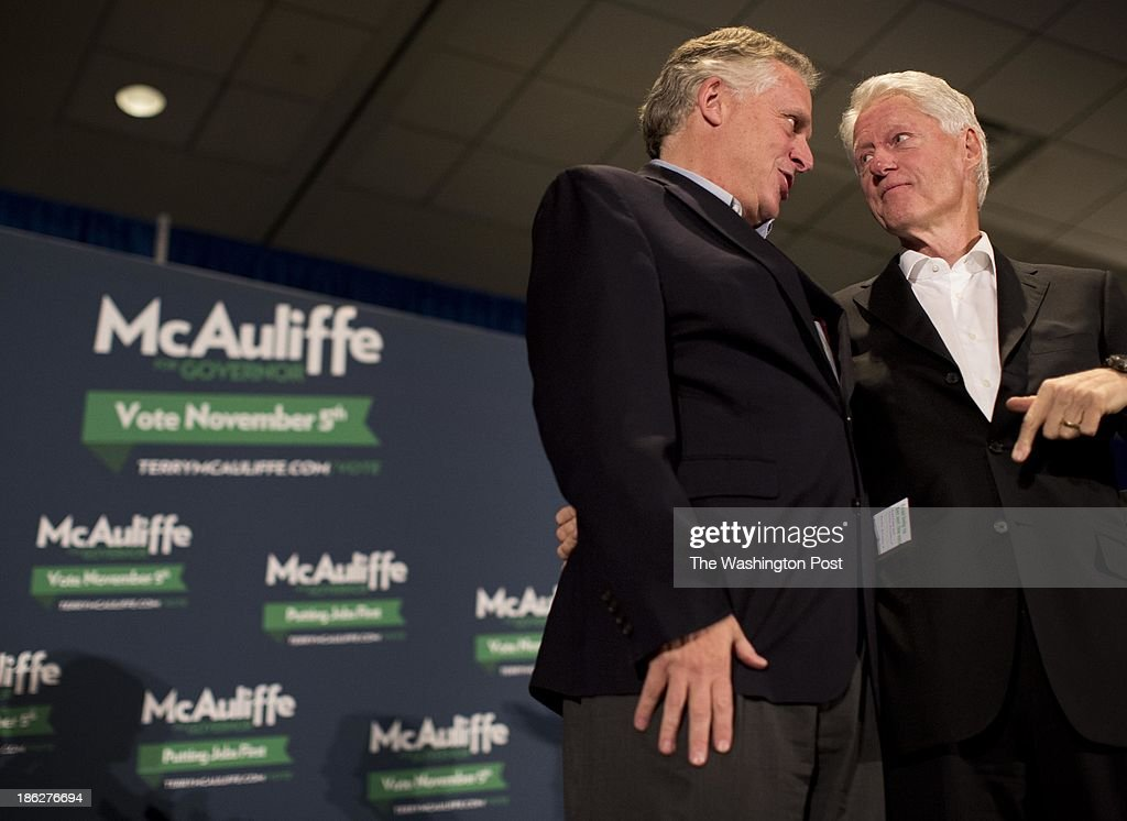 Virginia gubernatorial candidate Terry McAuliffe enters a campaign event with former President Bill Clinton in Harrisonburg, Virginia on Tuesday October 29, 2013. The old friends and political teammates have been traveling through the Commonwealth campaigning since Sunday, and will end the tour tomorrow evening in Roanoke.