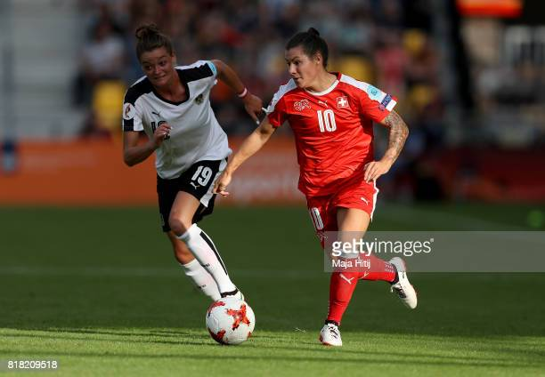 Virginia Kirchberger of Austria and Ramona Bachmann of Switzerland compete for the ball during the Group C match between Austria and Switzerland...