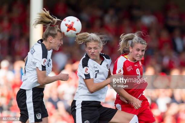 Virginia Kirchberger of Austria Carina Wenninger of Austria and AnaMaria Crnogoreevic of Switzerland battle for the ball during the Group C match...
