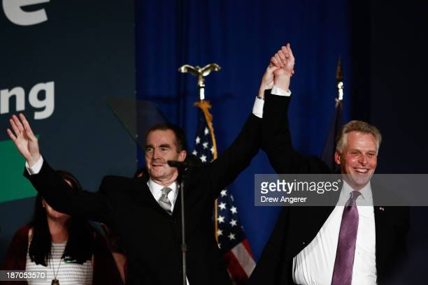 Virginia Lt Governorelect Ralph Northam and Virginia Governorelect Terry McAuliffe raise their hands together during an election night event November...