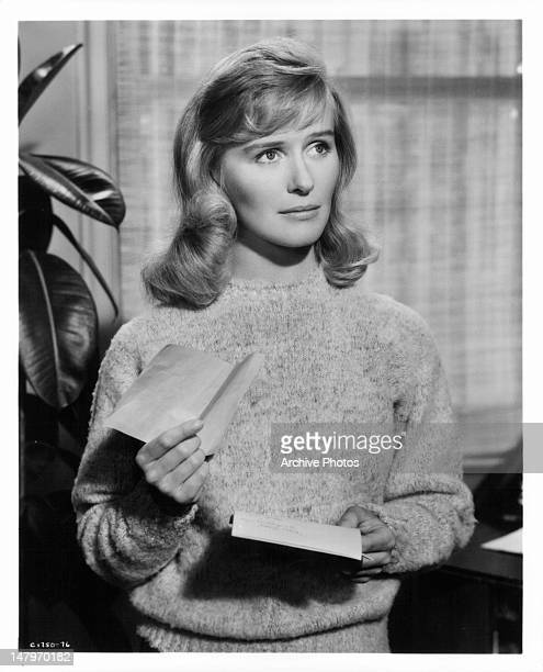 Virginia McKenna holding notes in a scene from the film 'The Wreck Of The Mary Deare' 1959
