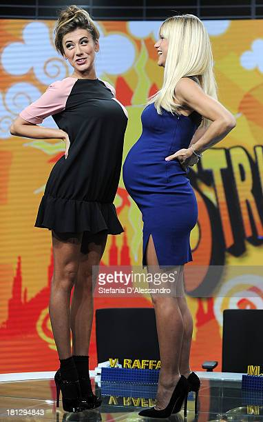 Virginia Raffaele and Michelle Hunziker attend 'Striscia La Notizia' TV Show Photocall on September 20 2013 in Milan Italy