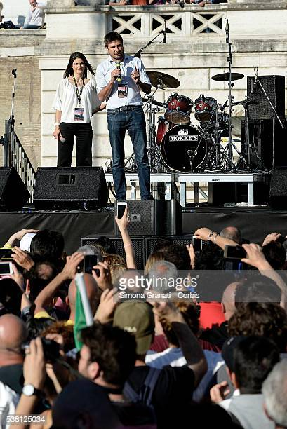 Virginia Raggi and Alessandro Di Battista speak during the closing of the electoral campaign of Virginia Raggi for Mayor of Rome standing for the...