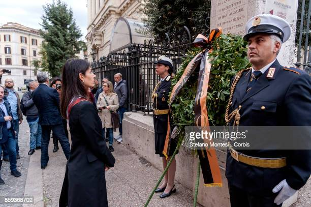 Virginia Raggi Mayor of Rome stands in front of a wreath during the commemoration of the 1982 terrorist attack at the Great Synagogue of Rome 1982 on...