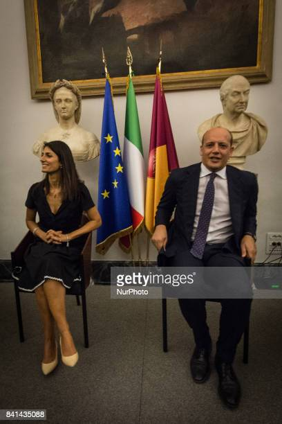 Virginia RaggiMauro Baldissoni during a press conference at Rome's Capitol Hill on August 31 2017 in Rome Italy The Brazilian soccer club that was...