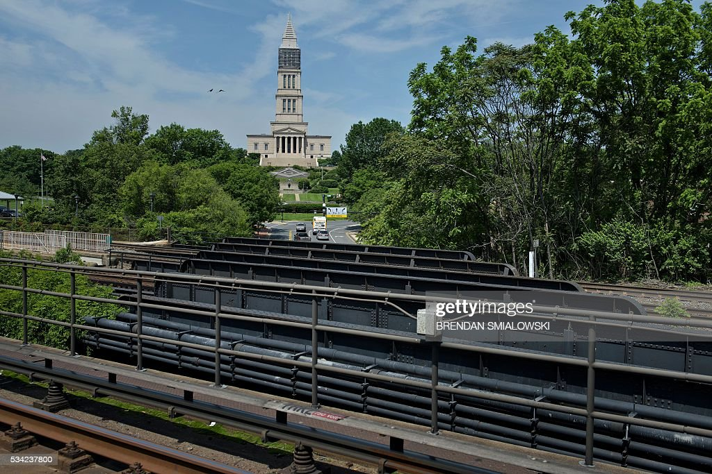Virginia rail tracks, Metro tracks and the Masonic Temple are seen in the Metro transit system May 25, 2016 in Alexandria, Virginia. / AFP / Brendan Smialowski