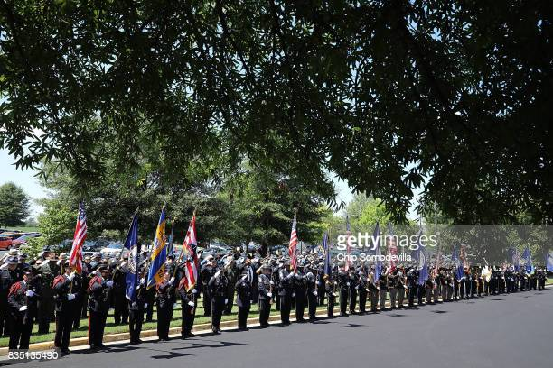 Virginia State Police and other law enforcement officers line the drive outside Saint Paul's Baptist Church during TrooperPilot Berke MM Bates's...