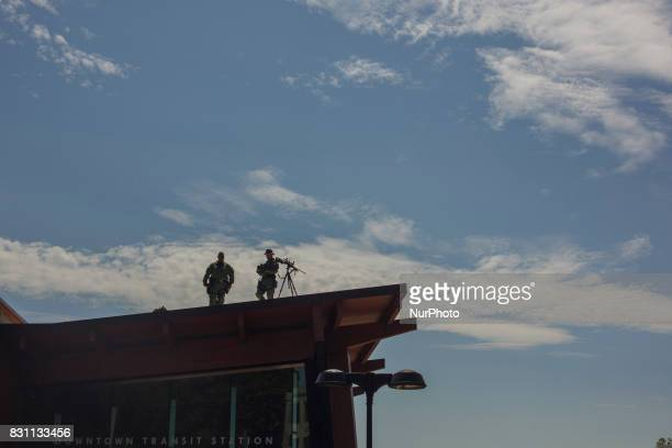 A Virginia State Police countersniper team stands watch before a news conference held by altright blogger Jason Kessler in front of City Hall August...