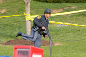 Virginia State Police officer wielding an assault rifle makes his way on campus at Virginia Tech after a bomb scare at Burress Hall two days after...