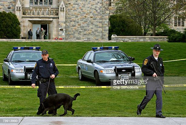 Virginia State police stand watch with explosivesniffing dogs outside Norris Hall after reports of a security alert on the campus of Virginia Tech...