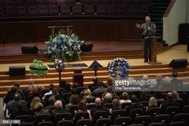Virginia State Police Superintendent Colonel Steven Flaherty delivers remarks during the funeral for TrooperPilot Berke MM Bates at Saint Paul's...