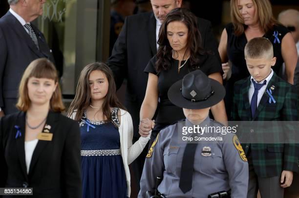 Virginia State Police TrooperPilot Berke MM Bates' family wife Amanda and 11yearold twin son and daughter leave Saint Paul's Baptist Church following...