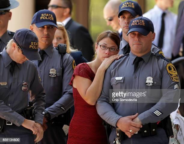 Virginia State Police wait outside Saint Paul's Baptist Church following TrooperPilot Berke MM Bates's funeral August 18 2017 in Richmond Virginia...