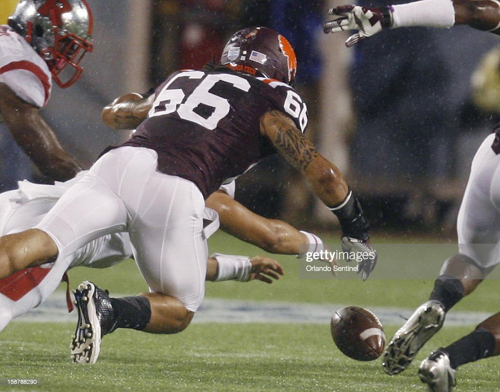 Virginia Tech defensive end Tyrel Wilson (66) goes after a Rutgers fumble in the Russell Athletic Bowl at the Florida Citrus Bowl in Orlando, Florida, on Friday, December 28, 2012. Virginia Tech defeated Rutgers, 13-10, in overtime.