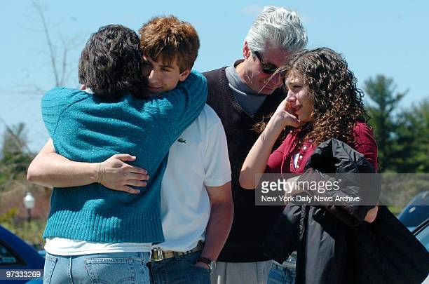 Virginia Tech freshman Scott Handy gets a hug of relief from mother Nadia as father David and sister Kristin look on in the parking lot of the Inn at...