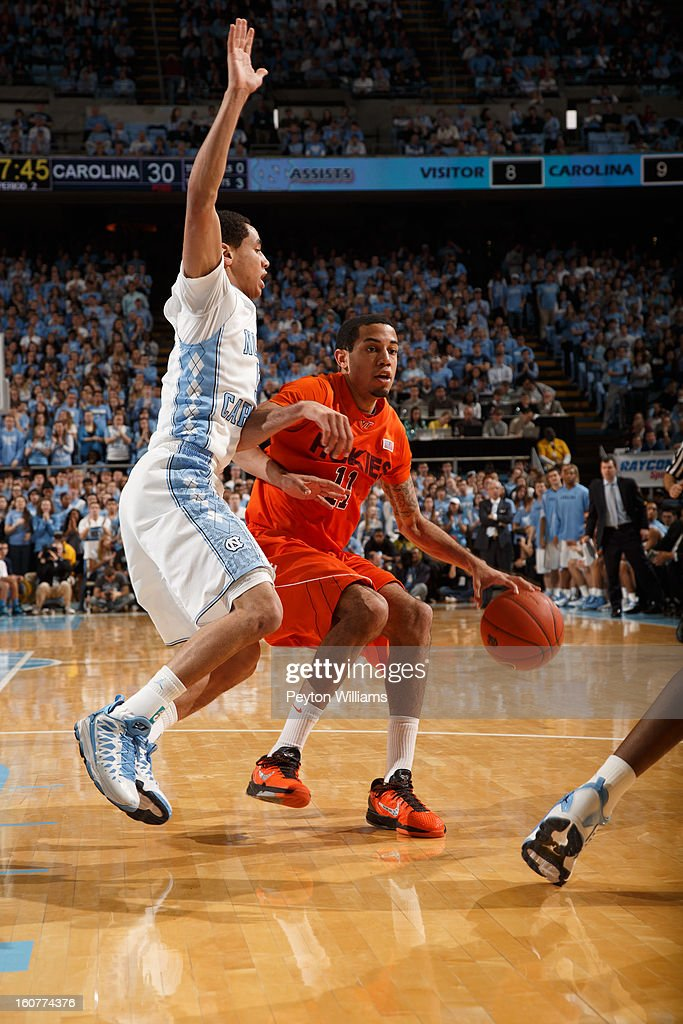 Virginia Tech Hokies guard Erick Green #11 dribbles around Marcus Paige #5 of the North Carolina Tar Heels on February 02, 2013 at the Dean E. Smith Center in Chapel Hill, North Carolina. North Carolina won 72-60 in overtime.