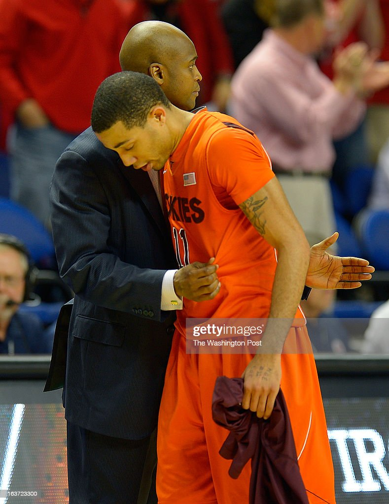 Virginia Tech Hokies guard Erick Green left is greeted by head coach James Johnson after being taken out of the game with with just a little over a...