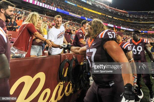 Virginia Tech Hokies guard Wyatt Teller celebrates with fans following the game against the West Virginia Mountaineers on September 3 at FedEx Field...