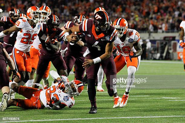 Virginia Tech Hokies quarterback Jerod Evans breaks a tackle from Clemson Tigers safety Van Smith before reaching the end zone for a rushing...