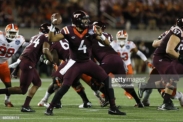 Virginia Tech Hokies quarterback Jerod Evans delivers a pass during the ACC Championship NCAA football game between the Clemson Tigers and Virginia...
