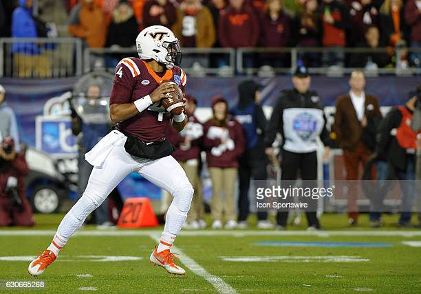 Virginia Tech Hokies quarterback Jerod Evans drops back looking to pass down field against the Arkansas Razorbacks in the Belk Bowl on December 29...