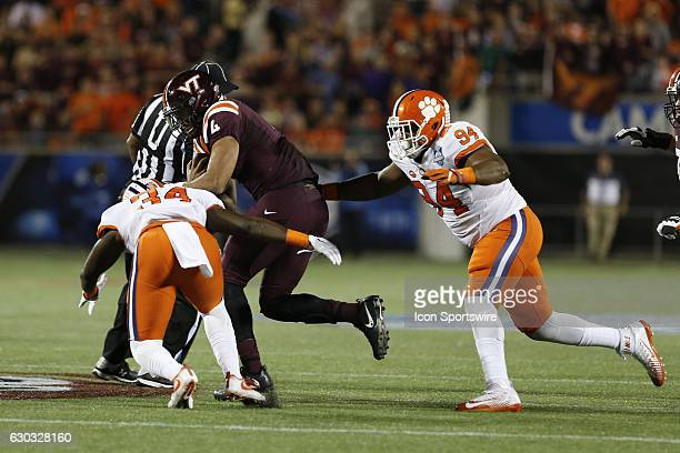 Virginia Tech Hokies quarterback Jerod Evans is tackled by Clemson Tigers linebacker Kendall Joseph and Clemson Tigers defensive tackle Carlos...