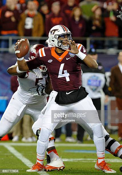Virginia Tech Hokies quarterback Jerod Evans pulls back to pass under by the Arkansas Razorbacks in the Belk Bowl between the Arkansas Razorbacks and...