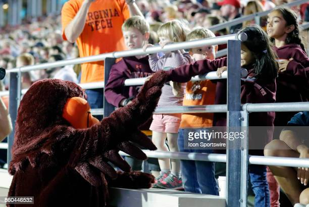 Virginia Tech mascot HokieBird entertains some young VT fans during a game between the Boston College Eagles and the Virginia Tech Hokies on October...