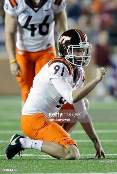 Virginia Tech punter Oscar Bradburn gets set to hold for a kick during a game between the Boston College Eagles and the Virginia Tech Hokies on...