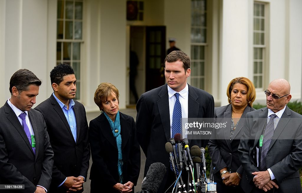 Virginia Tech shooting survivor Colin Goddard (C) speaks with other representatives of victims' groups and gun safety organizations after a meeting with Vice President Biden at the White House in Washington, DC, January 9, 2013, as part of the Administration's effort to develop policy proposals in response to the tragedy in Newtown, Connecticut. AFP Photo/Jim WATSON