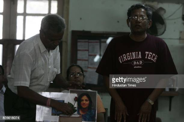 Virginia Tech Shootout Shekhar Ghate with wife geeta at the condolence meeting for minal panchal at sathaye college on sunday ghate's daughter snehal...
