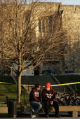 Virginia Tech students Elizabeth Strawn and Jeff Graham sit outside Norriss Hall site of yesterday's mass killings on the Virginia Tech campus April...