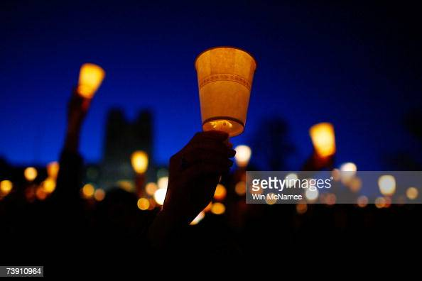 Virginia Tech students take part in a mass candlelight vigil to honor the victims of yesterday's shootings April 17 2007 in Blacksburg Virginia...