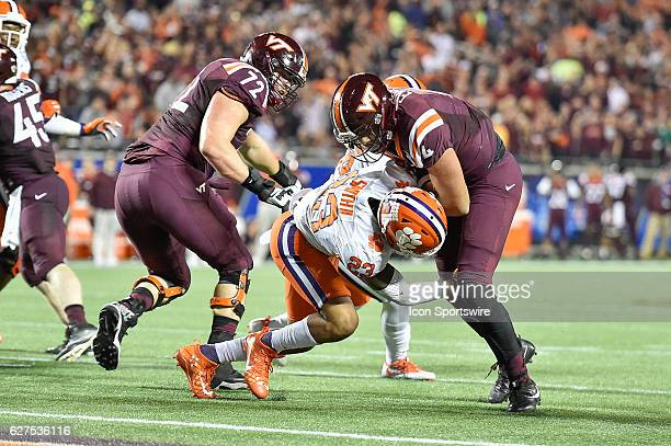 Virginia Tech University quarterback Jerod Evans gets tackled by Clemson University safety Van Smith at the one yard line during the ACC Championship...