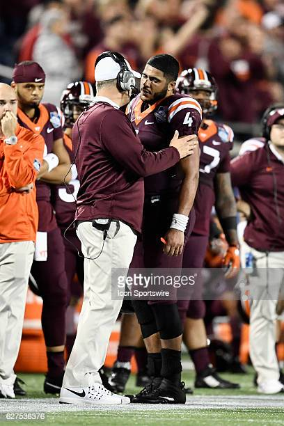 Virginia Tech University quarterback Jerod Evans is consoled by his Head Coach Justin Fuente after throwing an interception on fourth down with just...