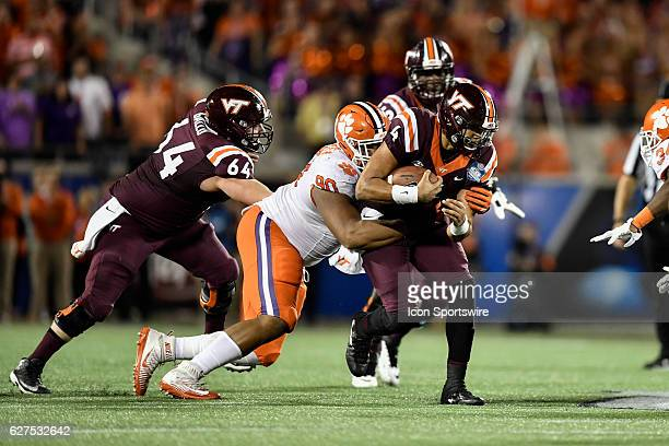 Virginia Tech University quarterback Jerod Evans is tackled by Clemson University defensive tackle Dexter Lawrence during the ACC Championship...