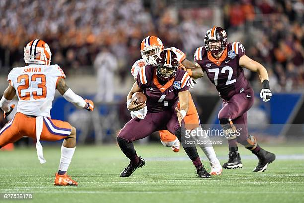 Virginia Tech University quarterback Jerod Evans runs into the secondary during the ACC Championship football game between the Clemson Tigers and the...