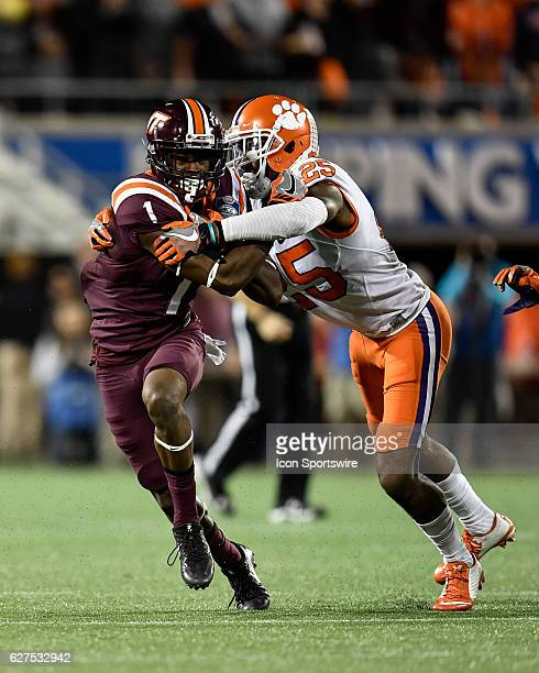 Virginia Tech University wide receiver Isaiah Ford is tackled by Clemson University cornerback Cordrea Tankersley after a reception during the ACC...