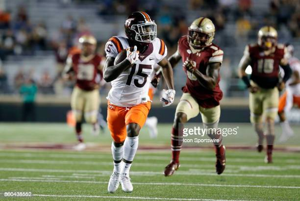 Virginia Tech wide receiver Sean Savoy checks for any danger on his way to a touchdown during a game between the Boston College Eagles and the...