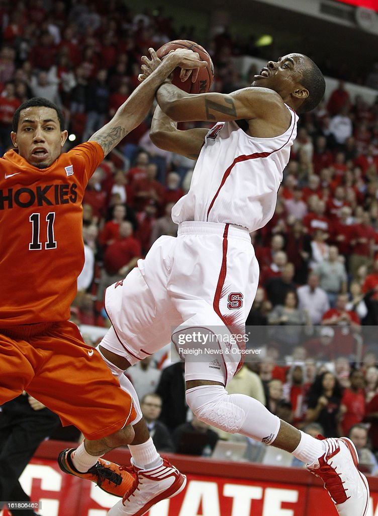 Virginia Tech's Erick Green (11) fouls North Carolina State's Lorenzo Brown (2) in overtime at PNC Arena in Raleigh, North Carolina, Saturday, February 16, 2013. N.C. State defeated Virginia Tech, 90-86.