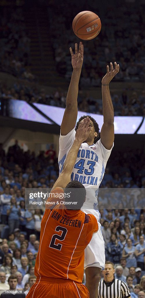 Virginia Tech's Joey van Zegeren (2) gets a hand in the face of North Carolina's James Michael McAdoo (43) during the second half at the Smith Center in Chapel Hill, North Carolina, Saturday, February 2, 2013. North Carolina won in OT, 72-60.