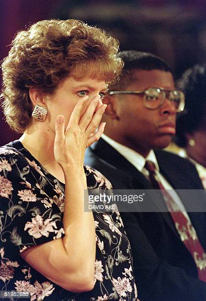 Virginia Thomas wife of US Supreme Court nominee Clarence Thomas wipes away tear as she listens to Judge Thomas's opening statement10 September 1991...