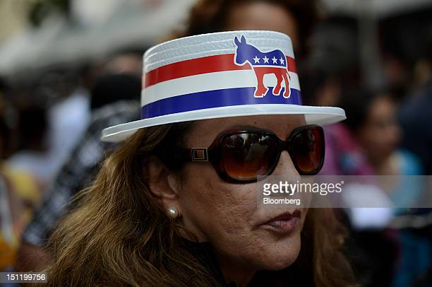 Virginia Vigil of Santa Fe New Mexico wears a hat branded with a donkey the symbol of the Democratic party during CarolinaFest 2012 ahead of the...